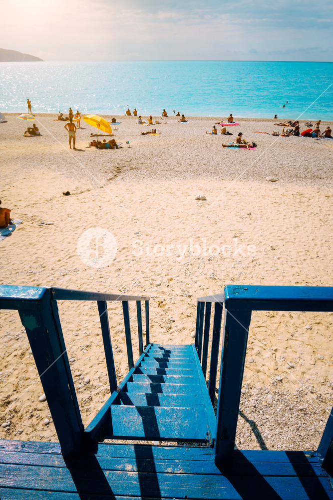 Beach panorama from the lifeguard rescue tower. Summertime summer holiday on mediterrean sea