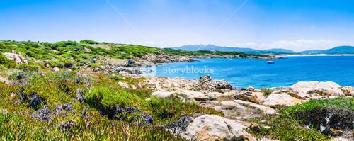 Beautiful costline with granite rocks and amazing azure water on Porto Pollo, Sardinia, Italy