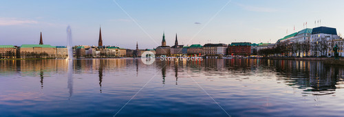Beautiful panoramic view of Alster river and Hamburg town hall - Rathaus at spring earning evening during golden hour