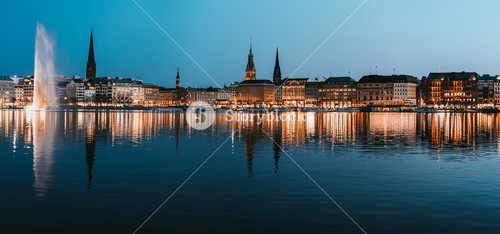 Beautiful panoramic view of Hamburg town hall - Rathaus and Alster river at spring earning evening during blue hour