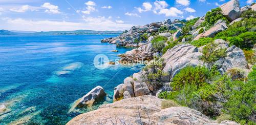 Bizarre granite rocks and amazing azure water on beautiful Sardinia island near Porto Pollo, Sargedna, Italy