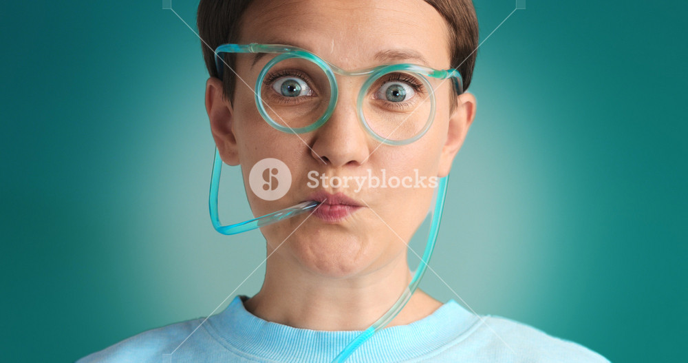blue eyed woman drinking lemonade using drinking straw glasses