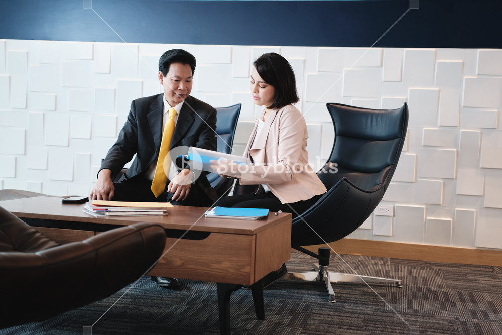 Business woman at work as advisor in office, financial consultant with client. Health insurance worker meeting Asian manager, explaining contract in waiting room