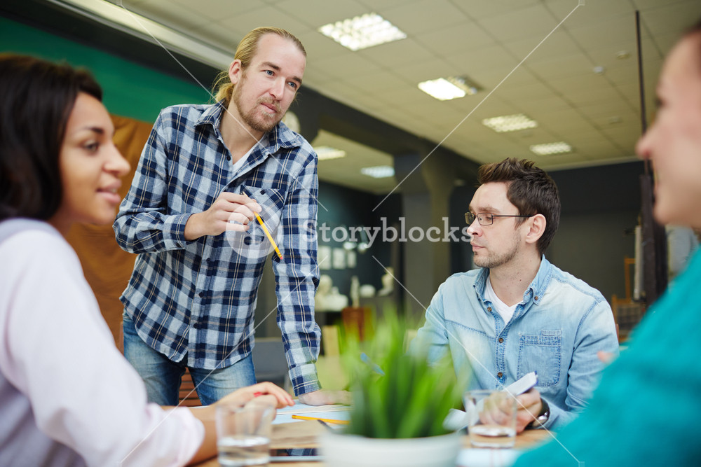 Businessman explaining his opinion to colleagues
