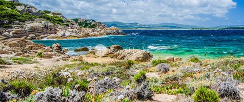 Costline of Costa Serena with sandstone rocks and sea waves, Sardinia, Italy