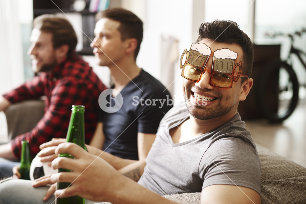 Football fan with funny glasses