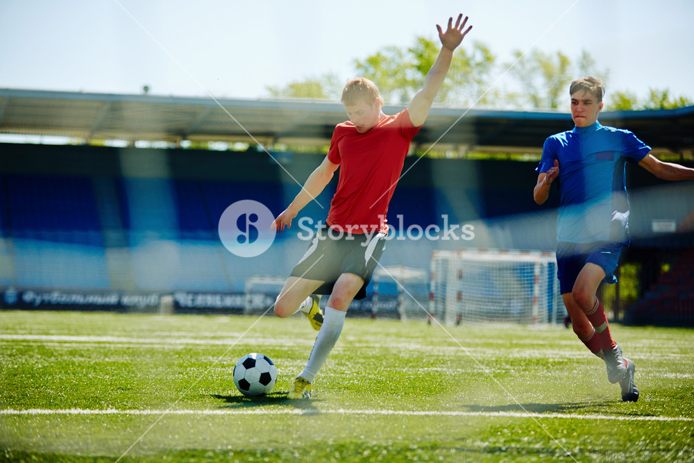 Football player going to shoot the goal