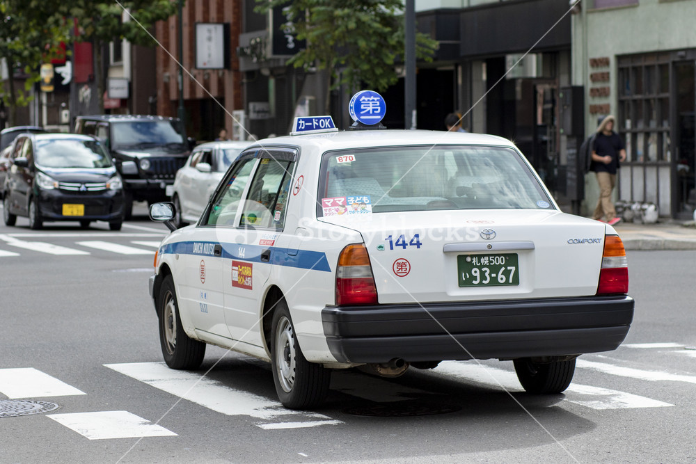 hokkaido japan - october8,2018 : old toyota taxi driving on sapporoa town street  hokkaido japan