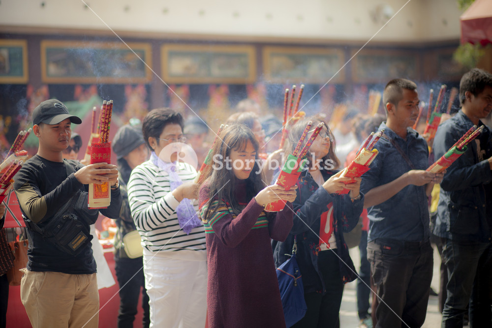 hongkong china - march16,2019 : large number of asian people praying to buddhist shrine with incenses in hongkong city religion traveling destination