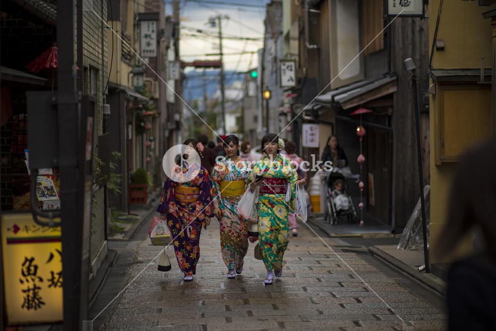 kyoto japan - november9,2018 : japanese woman wearing kimono clothes walking in yasaka shrine street most popular traveling destination in kyoto japan