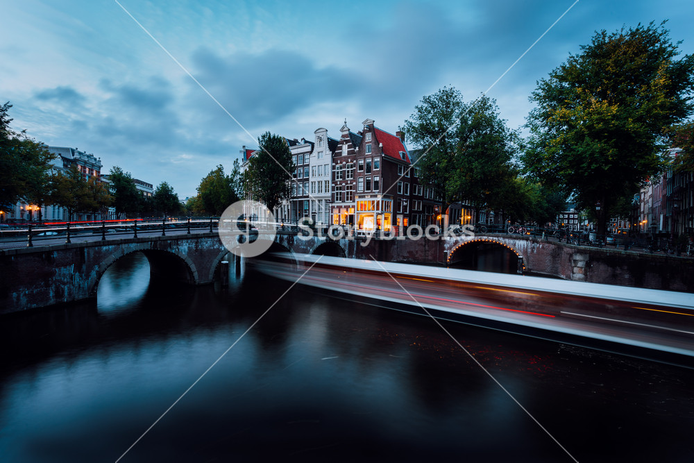 Light trails at the Leidsegracht and Keizersgracht canals in Amsterdam at dusk. Long exposure shot