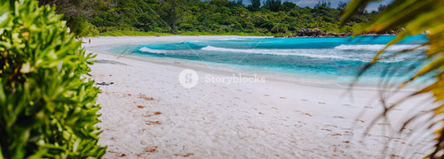 Panorama of white sandy tropical beach and blue lagoon on sunny lazy day. Vacation holidays concept. Heavenly place paradise, dream vacation
