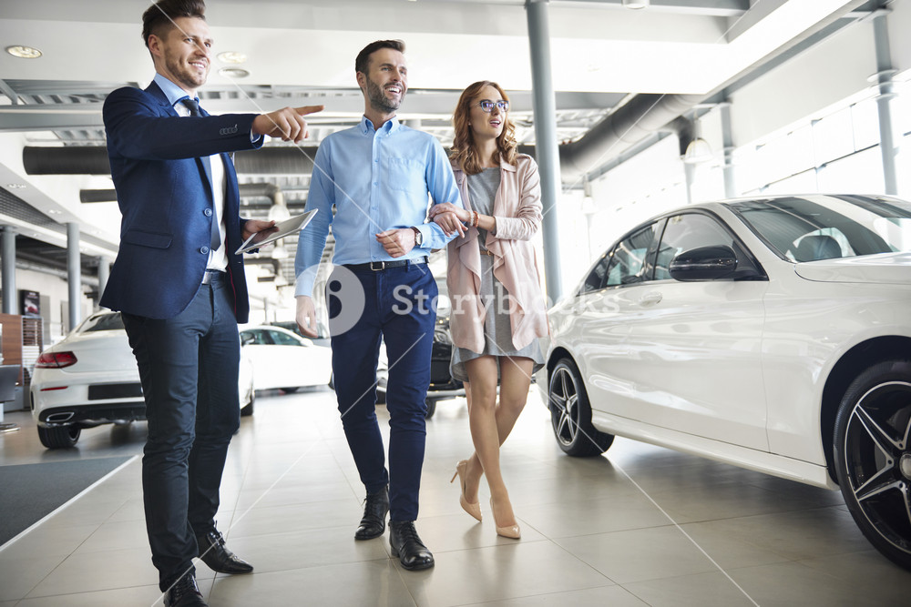 Salesman presenting special offers to clients