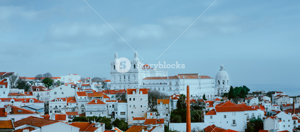 Scenery of Lisbon. Panoramaview of Alfama old town district on cloudy day, Lissabon, Portugal. Red-white colored