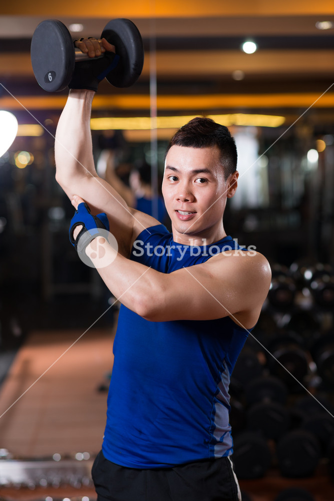 Strong Vietnamese man training his muscles