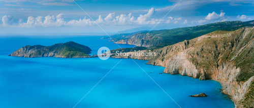 Stunning coastal panorama and beautiful clouds at the horizon on Kefalonia island. Mediterranean Sea summer coastal landscape