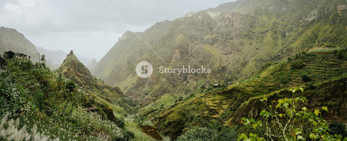 Trekking route to the Xo-Xo Valley. Harsh peaks and immense mountain walls around the ravine. Local dwellings built on the mountain ridge. Santo Antao island, Cape Verde