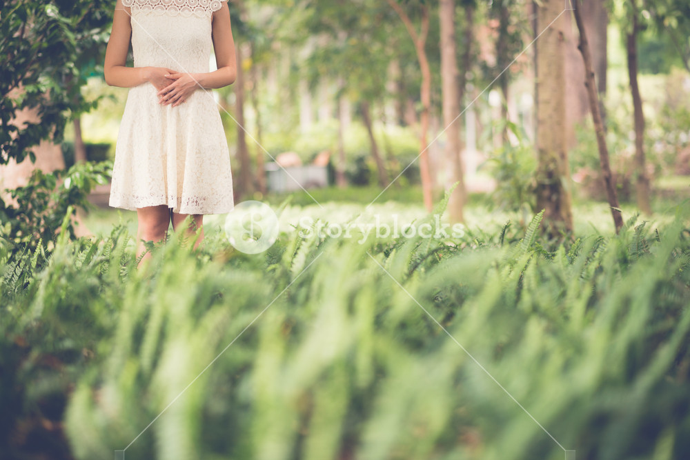 Unrecognizable woman standing in the forest