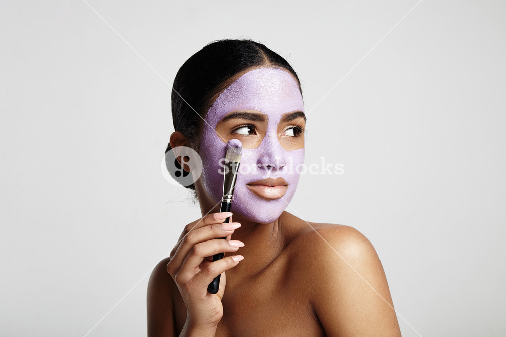 woman has fun with a facial mask