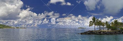 Sunlit, tropical island on the ocean