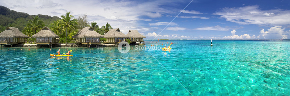 Thatched huts on the tropical ocean