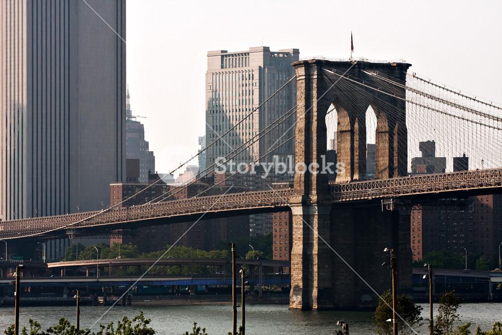 The Brooklyn Bridge and Manhattan New York City skyline near dusk.