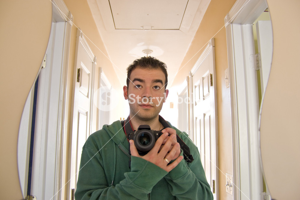 This is me - my self portrait.  I faced the curvy mirror at the end of the hallway.  Backlit lighting coming from the other end of the house.