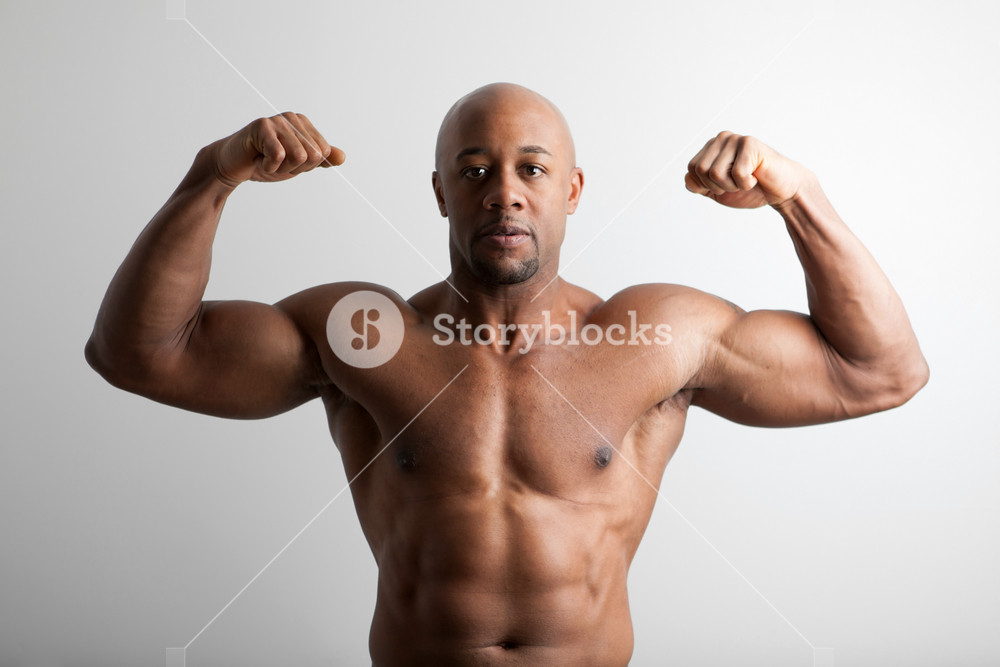 Toned and ripped lean muscle fitness body builder flexing.