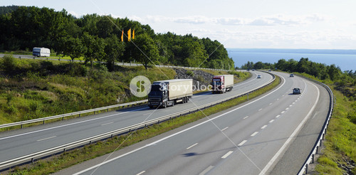 trucks driving on scenic freeway, elevated view