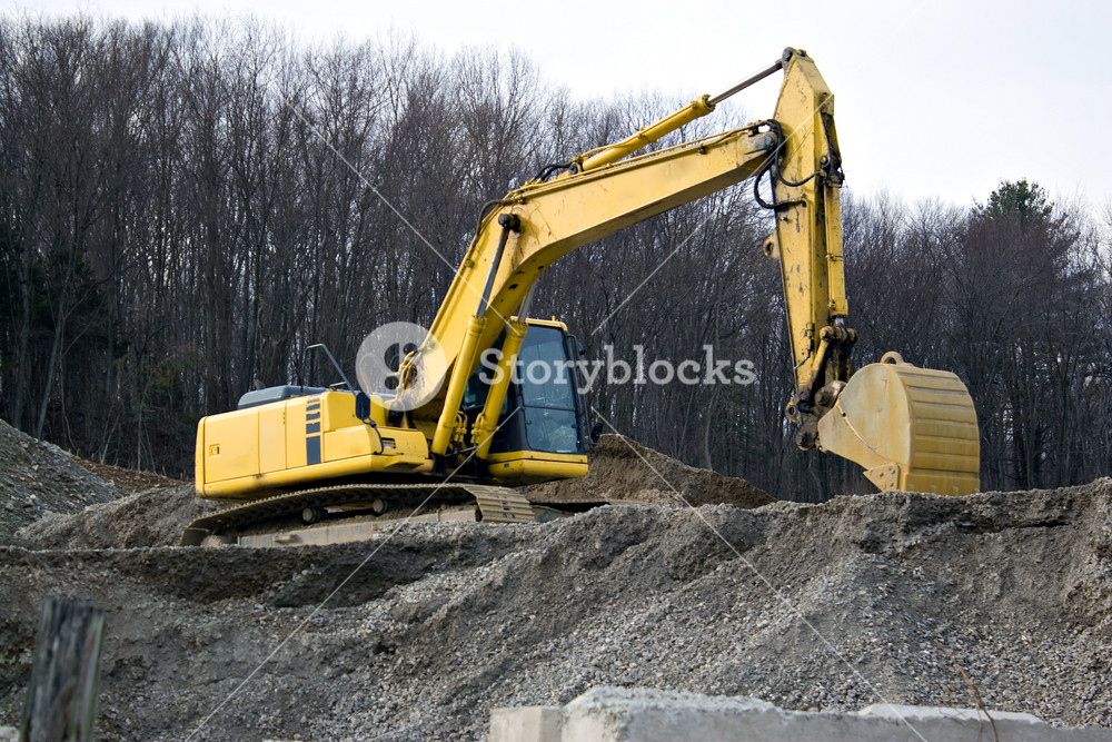 View of a construction site with heavy duty equipment.