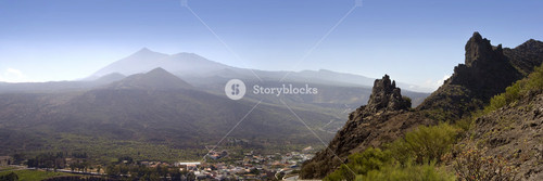 Village in a hazy mountain valley