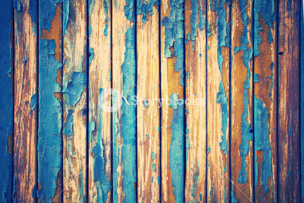 Vintage background from old wooden wall with peeling paint