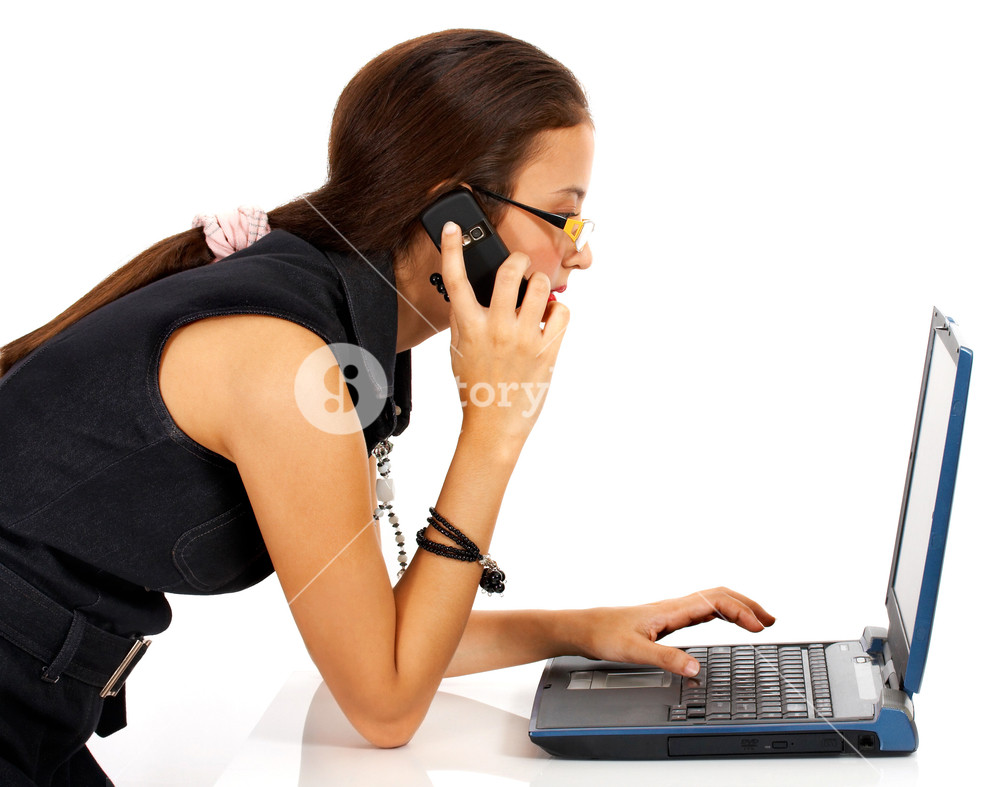 Young Woman On The Telephone And Computer