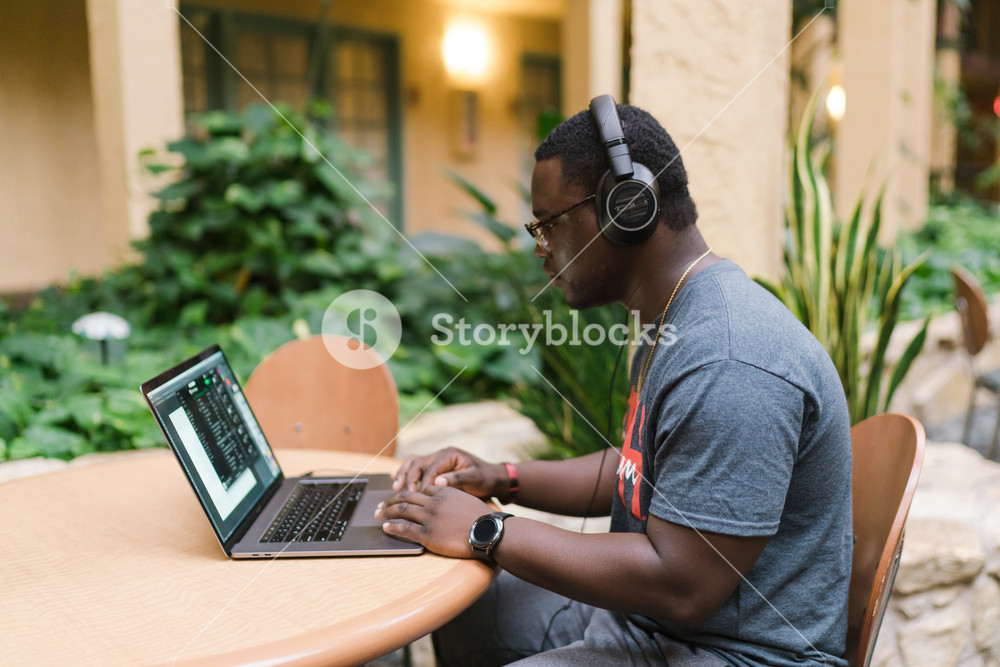 Black man working on his computer