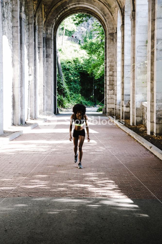 Black woman in athletic apparel